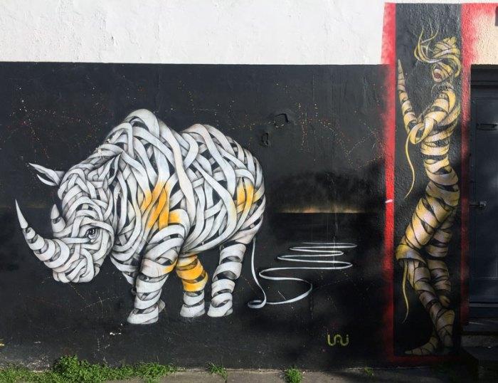 Rhino and Woman, Street Art by Otto Schade, London, Ribbon Style