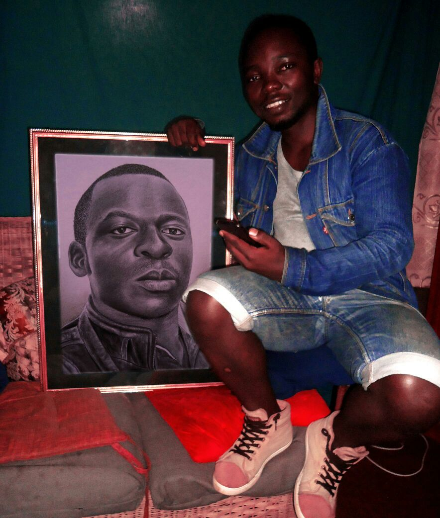 Rapsy posing with one of his drawings