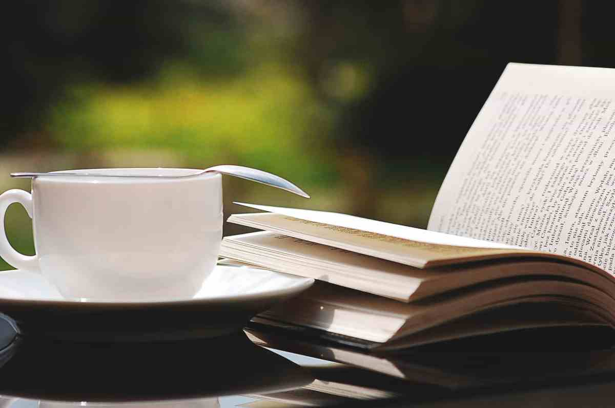 reading in a cafe