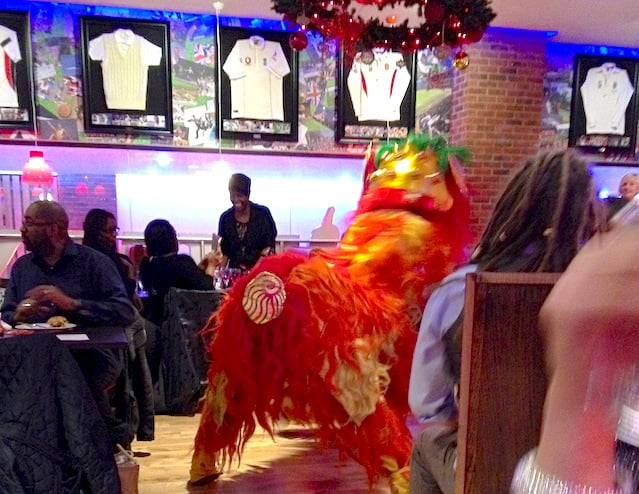 Jimmy World Grill people eating and Chinese lion dancer