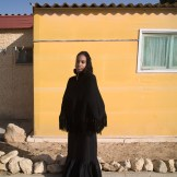 Woman and Yellow Wall, Village of Peace, Dimona, Israel