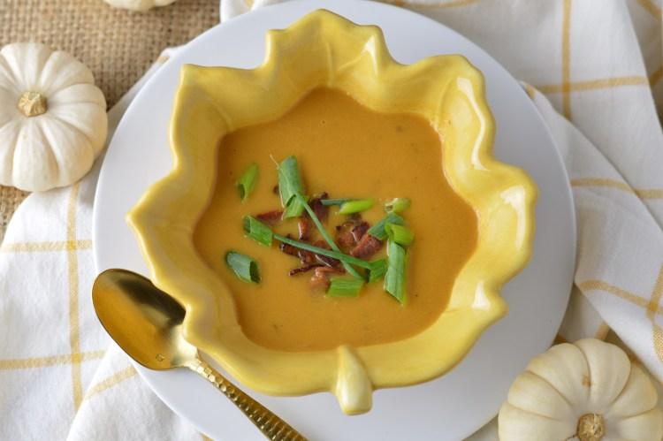 Sweet Potato Apple Soup w/Bacon in a gold, leaf-shaped bowl