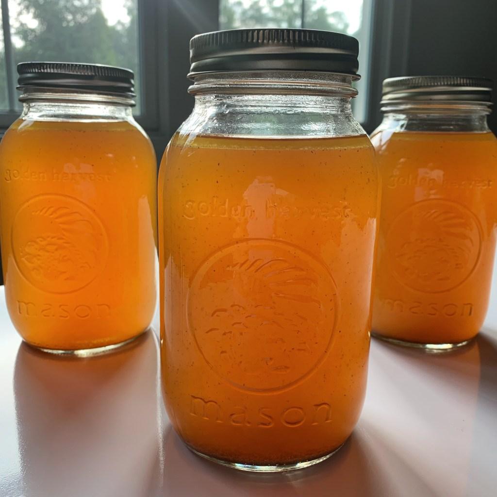 rich bone broth in mason jars