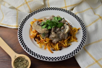 Allergy friendly hamburger stroganoff sitting atop roasted, spiralized butternut squash