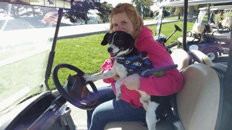 owney-driving-golf-cart