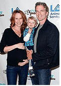Wendy Braun pregnant with family at Charity event.