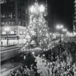 photo-chicago-state-street-night-christmas-season-start-in-front-of-fair-store-store-signs-1950s