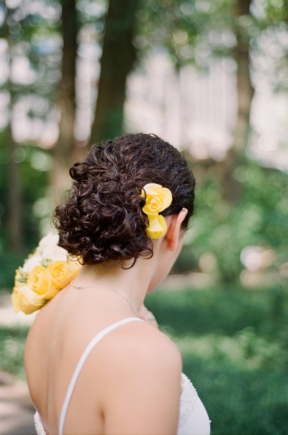 bridal hairdo with yellow flowers