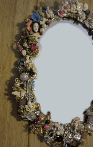 Vintage Netsuke Mirror, embellished by Wendy Gell and encrusted with vintage jewelry, netsukes, flowers and much, much, more! left sife detail