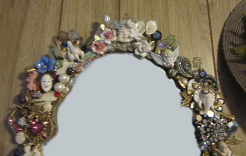 Vintage Netsuke Mirror, embellished by Wendy Gell and encrusted with vintage jewelry, netsukes, flowers and much, much, more! top detail