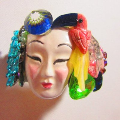asian face with toucan wristy cuff bracelet