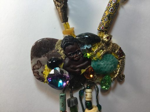 African Baby Necklace : close up of focus piece with dangles