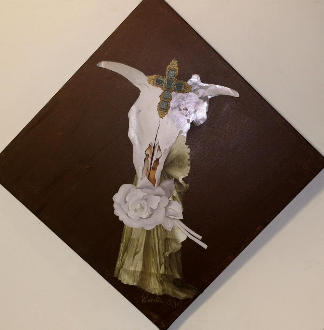 Wendy Gell as Wendia O'Gell - Georgia O'Keeffe Cow Skull with a gorgeous gown melting into it from behind and a magnificent cross. Ironic Iconic Paper Doll Collage