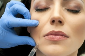 woman getting dermal filler injections