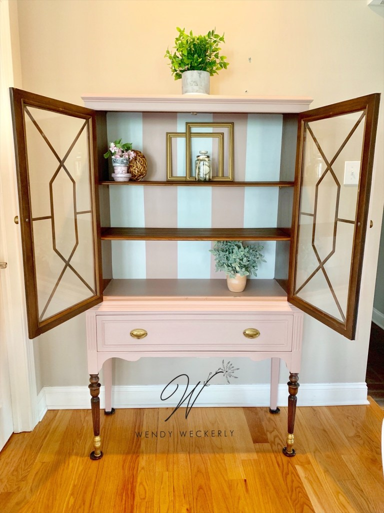 Old China or Hutch cabinet with white and pink stripes inside
