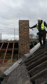 Chimney stack rebuilt above room 1, now safe and fit for purpose