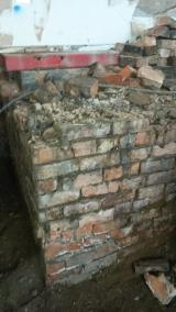 Damaged brickwork below room 1