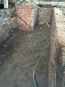 Parcels office floor removed revealing brick work and ground