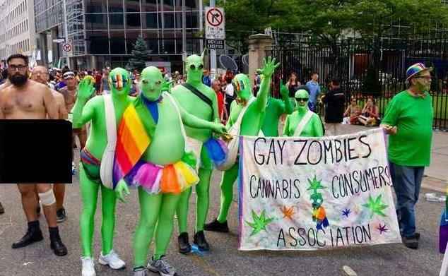 "Christian dressed as ""gay zombies"" in green suits"