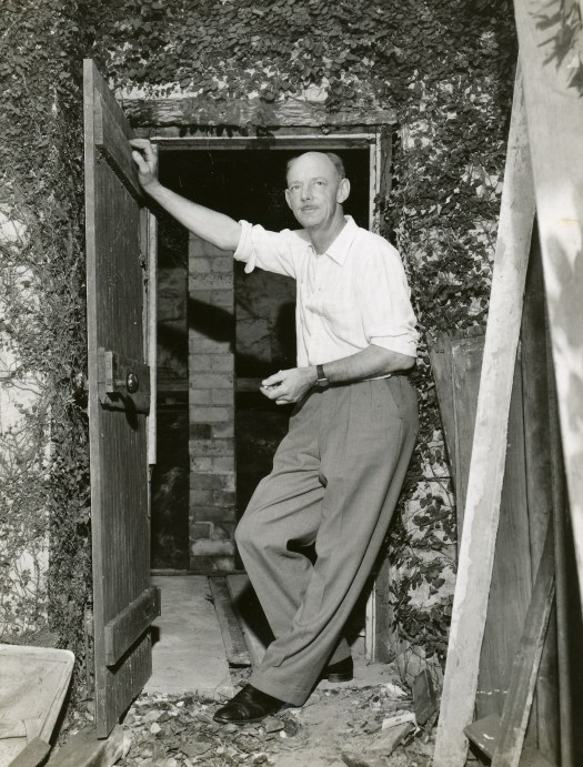 Bill Pidgeon (Wep) at the entrance to under his home at 85 Northwood Road where he kep his pottery wheel and kiln; Jan 1969