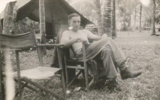 War Correspondent relaxing in camp at Labuan