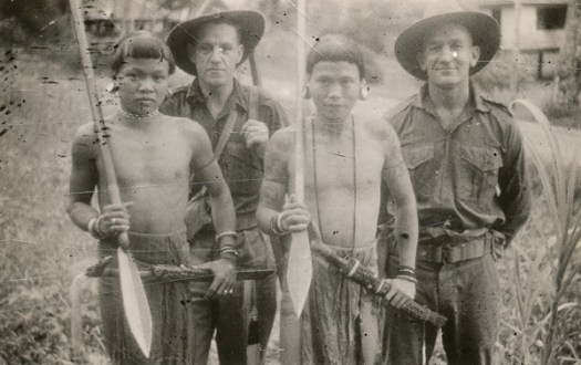 Dyak warriors with unidentified War Correspondents at Limbang, B