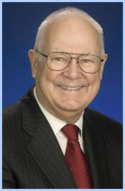 Dr John Husing