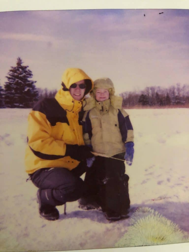 Man and son ice fishing together