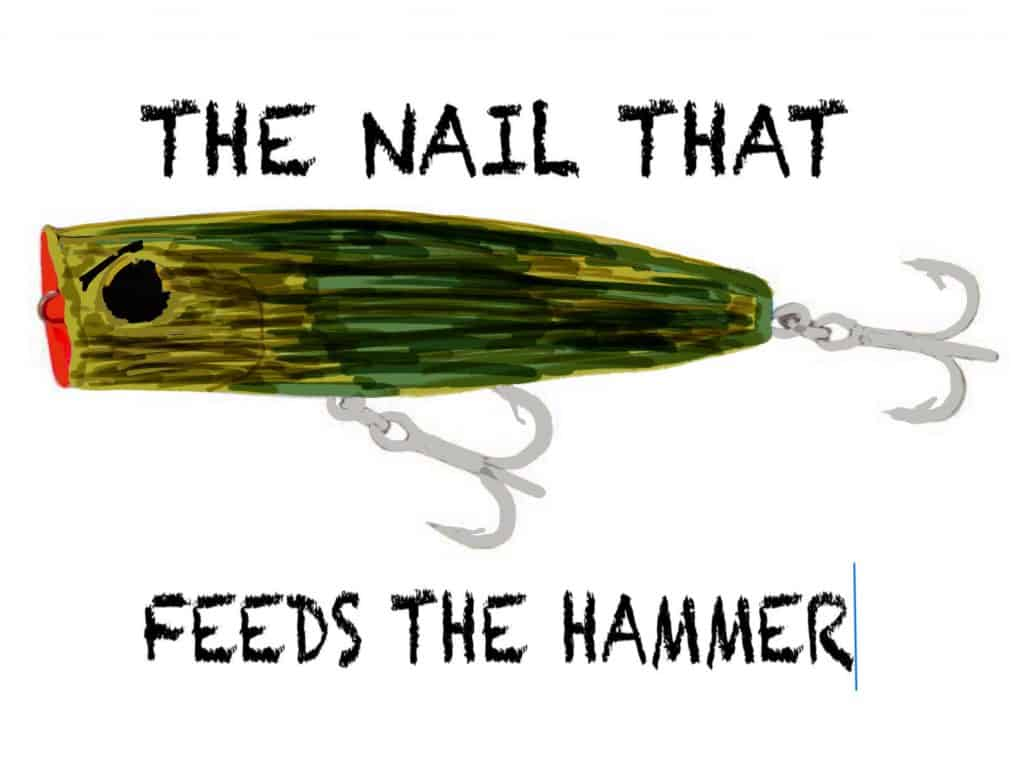 Top water lure with saying nail that feeds the hammer