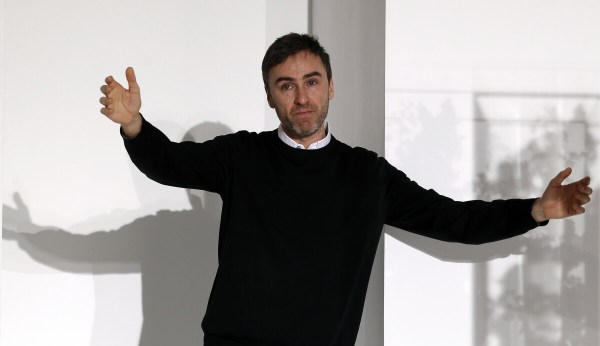 Belgian designer Raf Simons acknowledges audience applauses at the end of the Jil Sander 2012 Autumn/Winter collection show during Milan Fashion Week in this February 25, 2012 file photo. Simons is taking over as artistic director at Christian Dior, the Paris fashion house announced on April 9, ending months of speculation over who would replace his disgraced predecessor, John Galliano. Picture taken February 25, 2012. REUTERS/Alessandro Garofalo/Files (ITALY - Tags: FASHION)