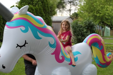 Riding giant unicorn Sprinkler