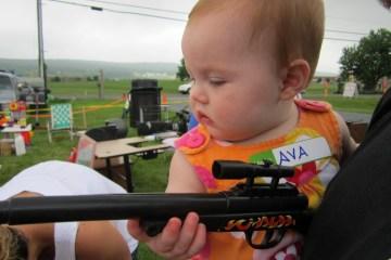 Ava holding a toy Gun
