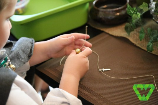 Parker making his Sting necklace. Hemp string.