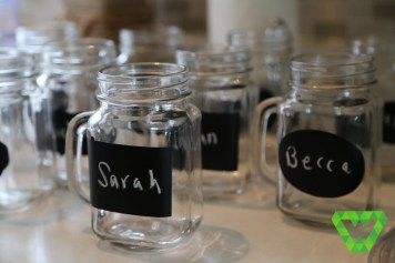 Reusable glass mugs with chalkboard stickers.