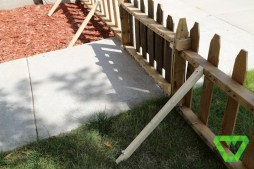 The palate fence posts. Simple tent stakes were used to keep it in the ground.
