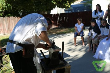 Watching the blacksmith from Wasatch Forge