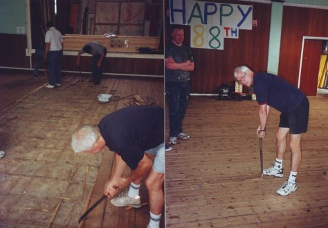 Volunteers start work on replacing the wooden floor in the main hall, 2002