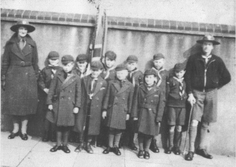 An early pic of 27th Woolwich Cub Scouts meeting outside Greenslade School ready to parade to Wesley Hall