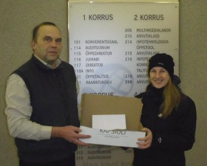 Volunteers receive proceeds from a Christmas fair which was used to feed needy families in Võru County