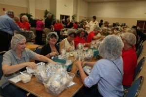 Hundreds of United Methodist volunteers help pack meals to ship to those in need through Rise Against Hunger (formerly Stop Hunger Now). Photo by Armando Rodriguez Jr.
