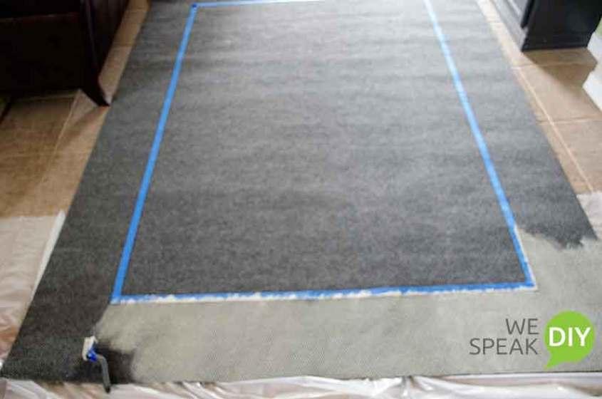 outdoor rug painting in progress