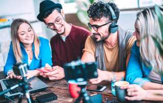 Group of Gen Z influencers using different devices and social media platforms to market a company's products and services.