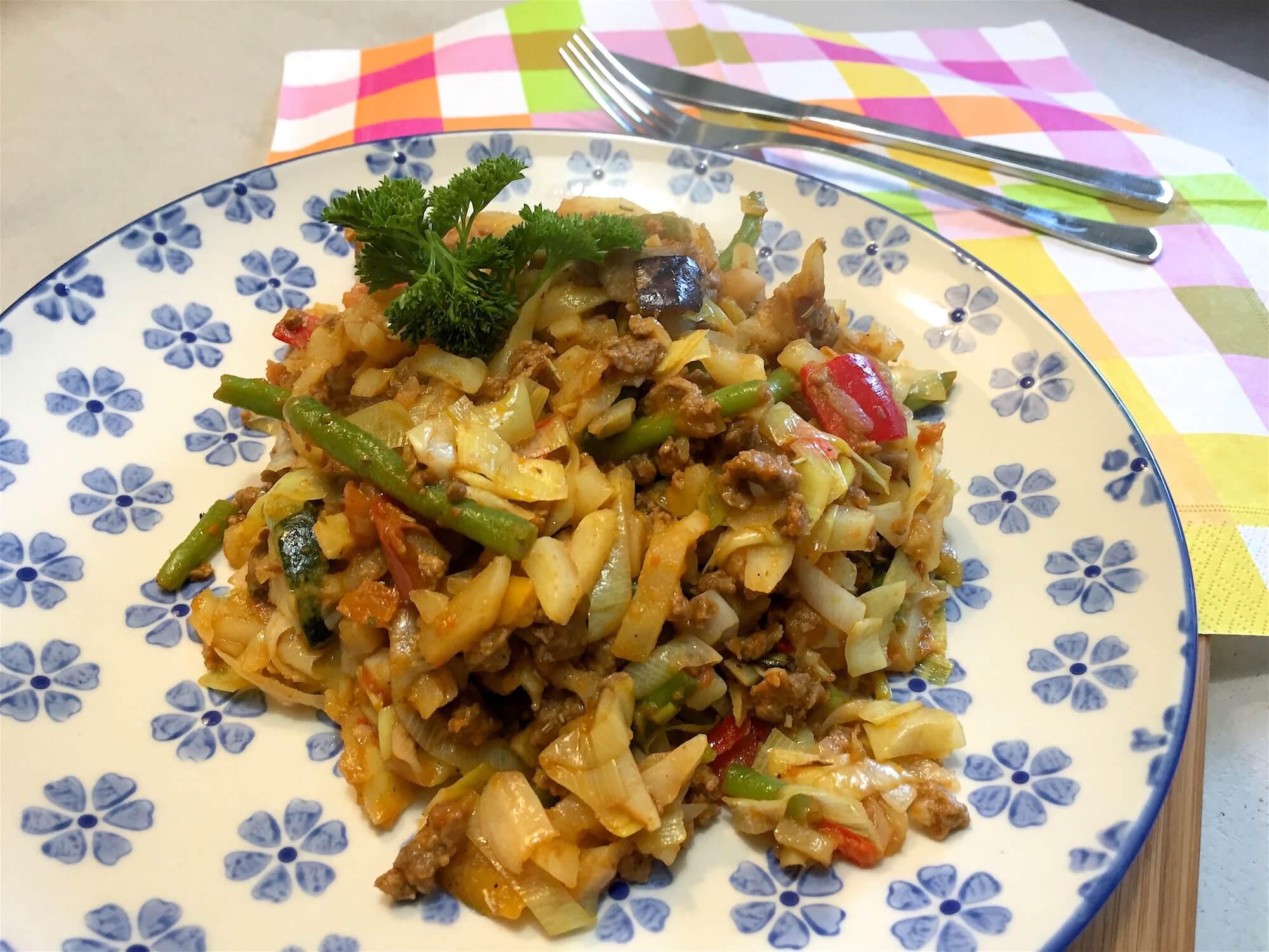 Aardappelschotel met groenten en rosti