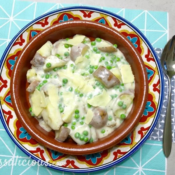 bijgerecht: Romige aardappelstukjes met doperwten