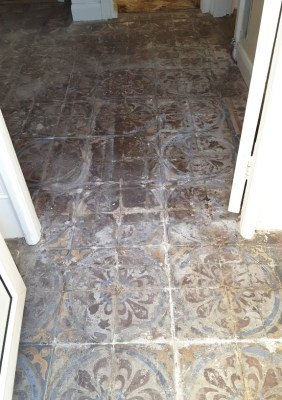 Encaustic tiled hallway before restoration in Chester