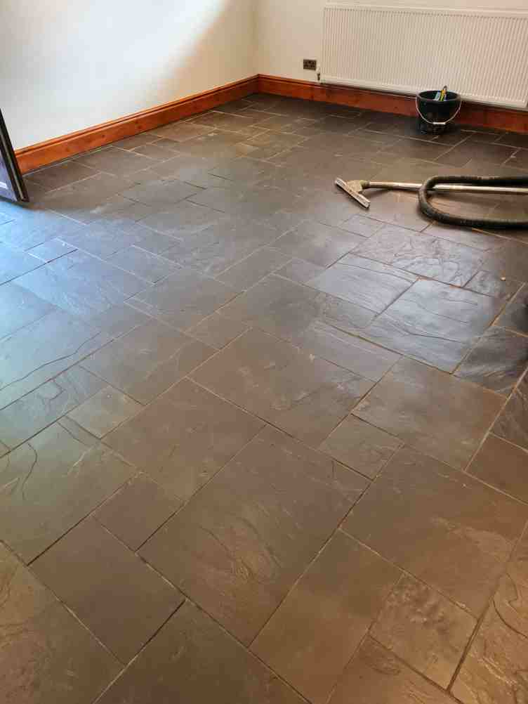 Slate Floor Before Cleaning in Holywell