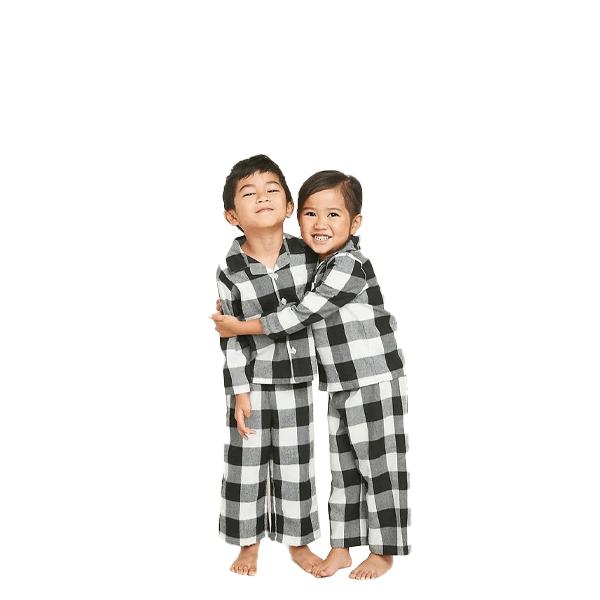 image of two kids in buffalo check pajamas