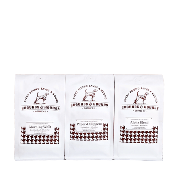 image of three bags of coffee with houndstooth pattern reading every pound saves a hound