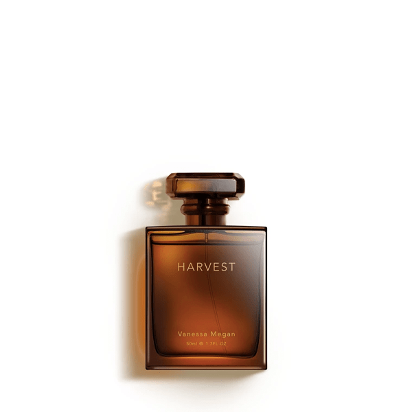 image of vanessa megan harvest natural perfume in amber bottle with square stopper and fine gold type on the lable