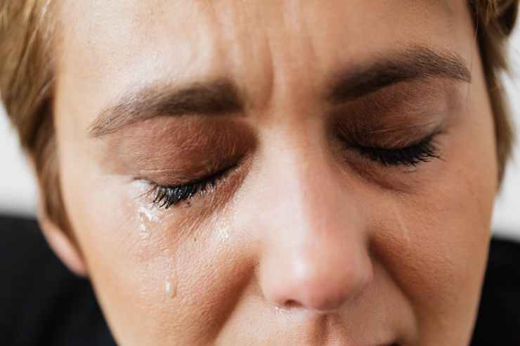 tears on face of crop anonymous woman